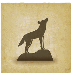 Howling wolf stands on rock vintage background vector