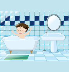 Boy taking bath in the bathroom vector