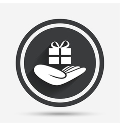 Give a gift sign Hand holds present box vector image
