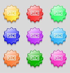 audio cassette icon sign symbol on nine wavy vector image vector image
