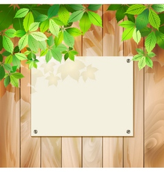 Green leaves on a wood texture background vector image vector image