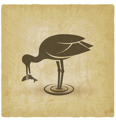 stork pulls fish out water vintage background vector image