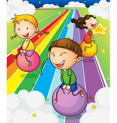 Three kids playing with the bouncing balls at the vector image