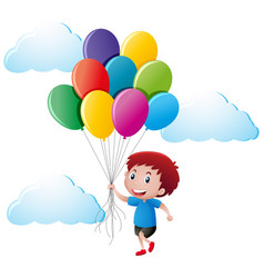 boy holding colorful balloons vector image