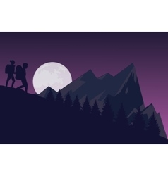 Silhouette of two people hiking during the night vector