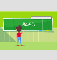 boy writing alphabet on chalkboard image vector image