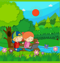 two kids working on computer in the park vector image