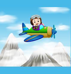A pilot riding a plane over mountain vector