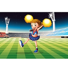 A cheerleader in the stadium vector image