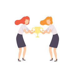 businesswomen fighting for trophy cup business vector image