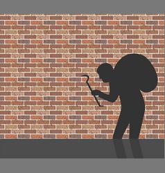 burglar in front of brick wall vector image vector image