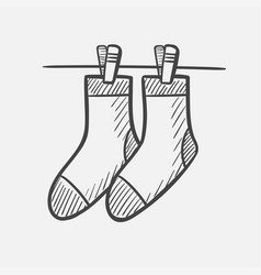 Socks on the clothesline hand drawn sketch icon vector