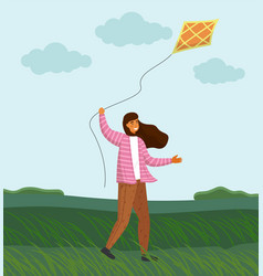 Girl playing with kite in windy weather on green vector