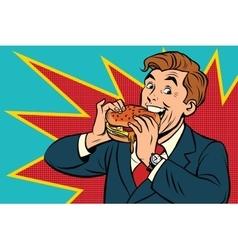 Pop art man eating a Burger vector image