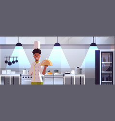Male professional chef cook holding covered vector