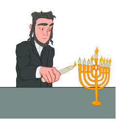 Young jewish man lights the candles on menorah vector