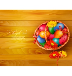 Easter background with color easter eggs in basket vector