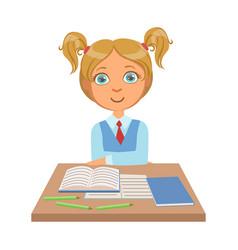 Little schoolgirl sitting at desk vector