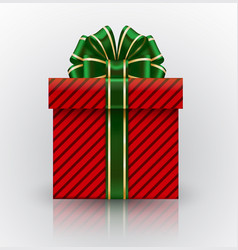 Red gift box with a big with green bow realistic vector