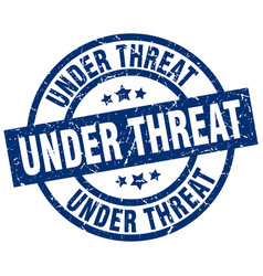 Under threat blue round grunge stamp vector
