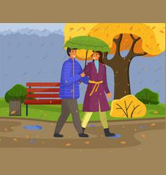 Married couple walks in autumn rainy nature city vector