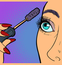 woman paints eyelashes makeup vector image