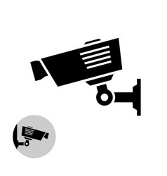 security camera simple black icon on the wall vector image