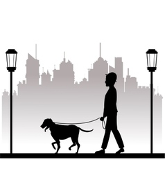 silhouette man with dog walking park city vector image