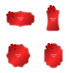 A set of four tags with red bows on a red vector image