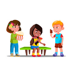 group of boys and girls eating together vector image