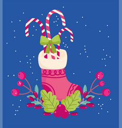 Merry christmas stocking with candies cane holly vector