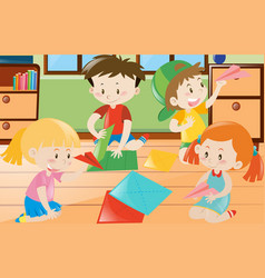 Boys and girls folding paper in room vector
