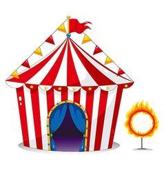A circus tent beside a ring of fire vector image