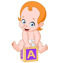 Baby on alphabet cube vector image