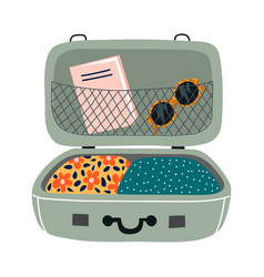 Isolated open suitcase with things travel bag vector