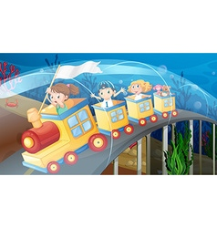 Children riding on train in the tunnel vector