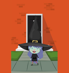 Little girl with witch costume in house door vector