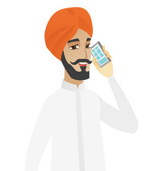 Hindu businessman talking on a mobile phone vector