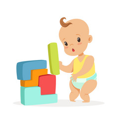 cute baby standing and playing with toy blocks vector image