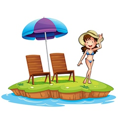 An island with a young girl swimming vector image