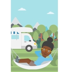 Woman lying in hammock in front of motor home vector image vector image