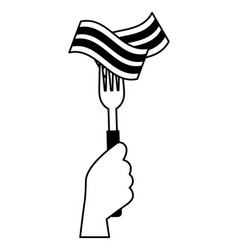 Hand holding fork with bacon vector