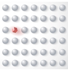Red cube among white spheres standing out vector