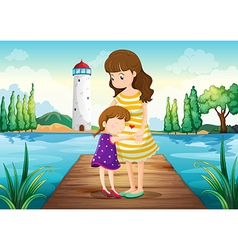 A young girl hugging her mother at the bridge vector