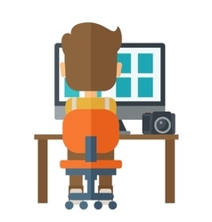 Man with laptop and camera on a table vector
