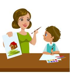 teacher teaching a boy how to paint elementary vector image