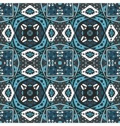 Ethnic geometric tiled seamless pattern vector