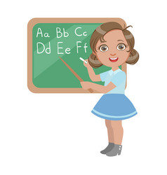 cute little girl standing near the blackboard and vector image