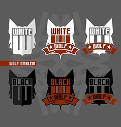 Black wolf and white wolf emblems vector