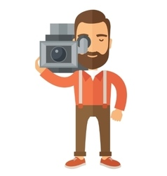 Videographer with his video camcorder vector